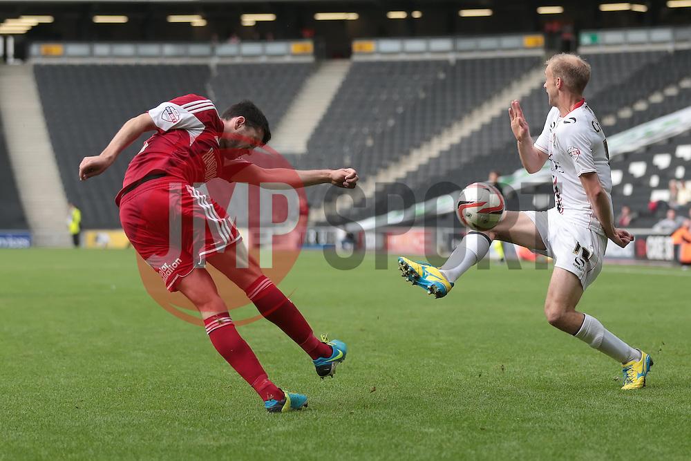 Bristol City's Brendan Moloney hits the ball against Milton Keynes Dons' Luke Chadwick  - Photo mandatory by-line: Nigel Pitts-Drake/JMP - Tel: Mobile: 07966 386802 24/08/2013 - SPORT - FOOTBALL - Stadium MK - Milton Keynes - Milton Keynes Dons V Bristol City - Sky Bet League One