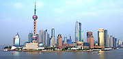 The Shanghai Pudong Skyline, including the Oriental Pearl TV Tower (left), is seen from the Bund side in Shanghai, China, on April 18, 2007. Photographer: Lucas Schifres/Pictobank