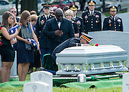 1st Lt. Matthew Greeene kneels down and kisses coffin holding his father, U.S. Army Major. Gen. Harold J. Greene, who was buried in Section 60 at Arlington National Cemetery on Thursday, August 14, 2014 with full military honors that included a caisson, two escort platoons, casket team, firing party, colors team, band a caparisoned horse, and a 13 gun (cannon) salute. Major Gen. Greene became the highest ranking casualty during the war in Afghanistan after he was killed by an Afghan soldier on August 5.  (Alan Lessig/Staff)