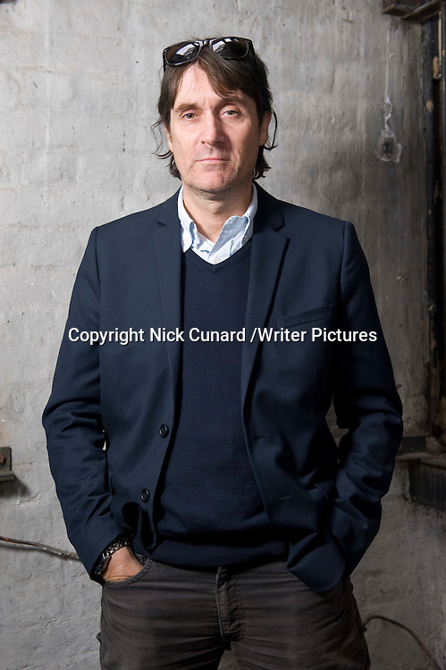 Neal Purvis, screenwriter<br /> Photographed at 46 Lexington St, London<br /> 12th October 2012<br /> <br /> Picture by Nick Cunard/Writer Pictures<br /> <br /> WORLD RIGHTS