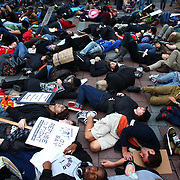 People participate in a 'die-in' during a combined Occupy Seattle and Act Now to Stop War and End Racism (ANSWER) protest at Westlake Park on Friday, October 7, 2011. Hundreds of people gathered for the two coinciding protests. (Joshua Trujillo, seattlepi.com)