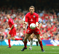 CARDIFF, WALES - SATURDAY MARCH 26th 2005: Wales' Craig Bellamy in action against Austria during the Wold Cup Qualifying match at the Millennium Stadium. (Pic by Jason Cairnduff/Propaganda)