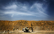 A worker watches over a mining drill in the main pit of the Youga gold mine near the town of Youga, approximately 205 km southeast of Burkina Faso's capital Ouagadougou on Tuesday April 28, 2009.