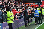 Brentford Manager Thomas Frank celebrates their 3-0 victory with fans after the EFL Sky Bet Championship match between Brentford and Queens Park Rangers at Griffin Park, London, England on 2 March 2019.