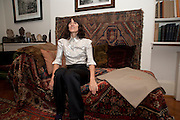 BELLA FREUD ON FREUD'S COUCH, Freud Museum dinner, Maresfield Gardens. 16 June 2011. <br /> <br />  , -DO NOT ARCHIVE-© Copyright Photograph by Dafydd Jones. 248 Clapham Rd. London SW9 0PZ. Tel 0207 820 0771. www.dafjones.com.