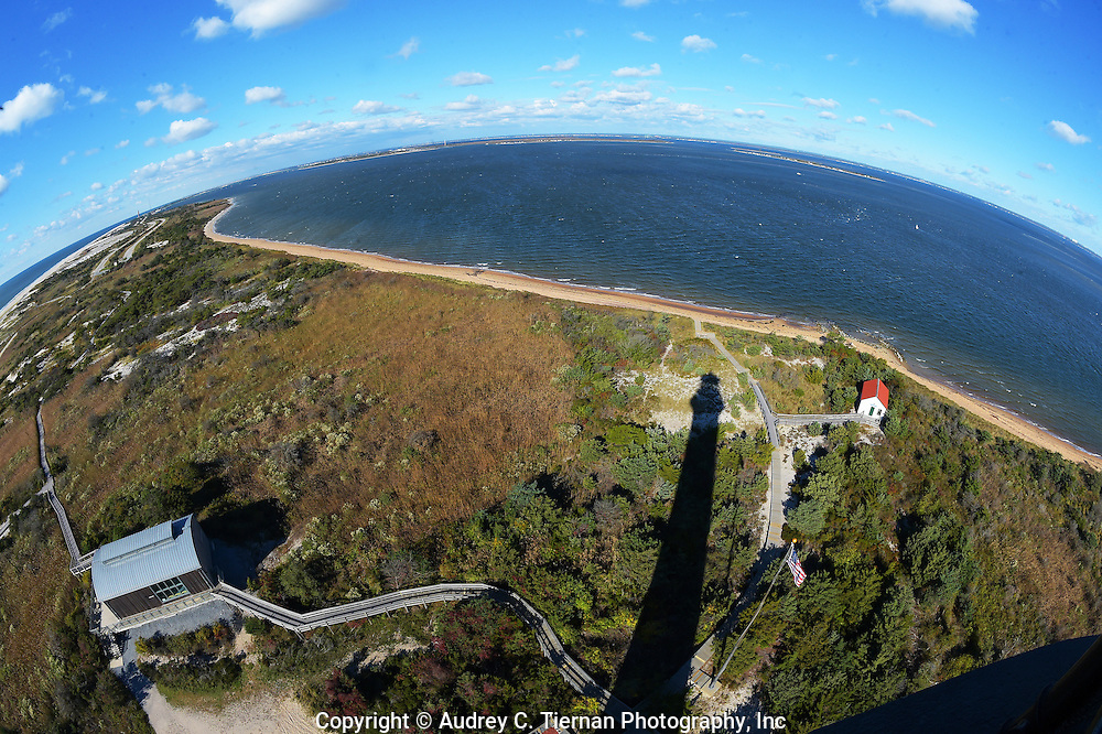 Babylon, NY,  October 25, 2016: ---  Looking down from the gallery of the Fire Island Lighthouse at the boat house, the Great South Bay and a reflection of the lighthouse.     © Audrey C. Tiernan