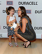 Hilary Swank, actress and daughter of a retired Air Force Senior Master Sergeant, hugs Mackenzie, 3, daughter of Navy Air Traffic Controller First Class Robert Nilson, at the premiere of Duracell's new film, The Teddy Bear, that shines a light on military families and supports the USO, Thursday, July 2, 2015, at The Times Center in New York.   The film, inspired by the Nilsons, was released in time for the July Fourth holiday weekend and can be viewed at youtube.com/Duracell.   (Photo by Diane Bondareff/Invision for Duracell/AP Images)