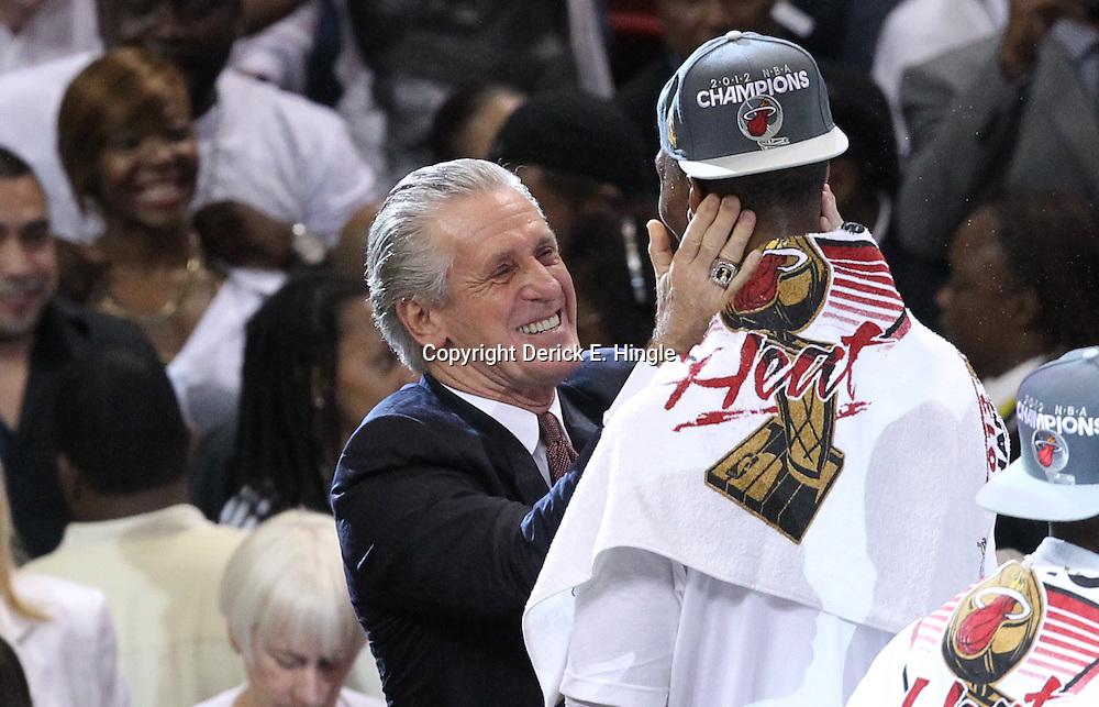 Jun 21, 2012; Miami, FL, USA; Pat Riley hugs Miami Heat power forward Chris Bosh (1) after winning the 2012 NBA championship at the American Airlines Arena. Miami won 121-106. Mandatory Credit: Derick E. Hingle-US PRESSWIRE