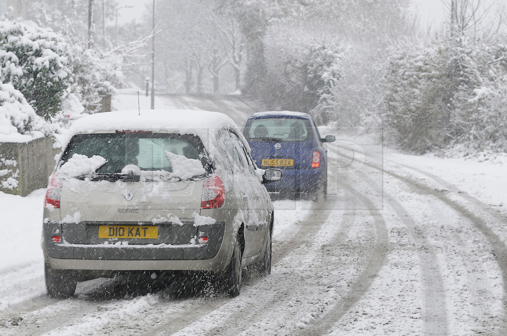 © under license to London News Pictures. 30.11.2010 Cars driving in the snow on Chelsfield Lane, Orpington,Kent. Picture credit should read Grant Falvey/London News Pictures