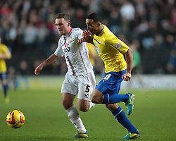 Milton Keynes Dons' Lee Hodson and Coventry City's Callum Wilson challenge for the ball - Photo mandatory by-line: Nigel Pitts-Drake/JMP - Tel: Mobile: 07966 386802 30/11/2013 - SPORT - Football - Milton Keynes - Stadium mk - MK Dons v Coventry City - Sky Bet League One