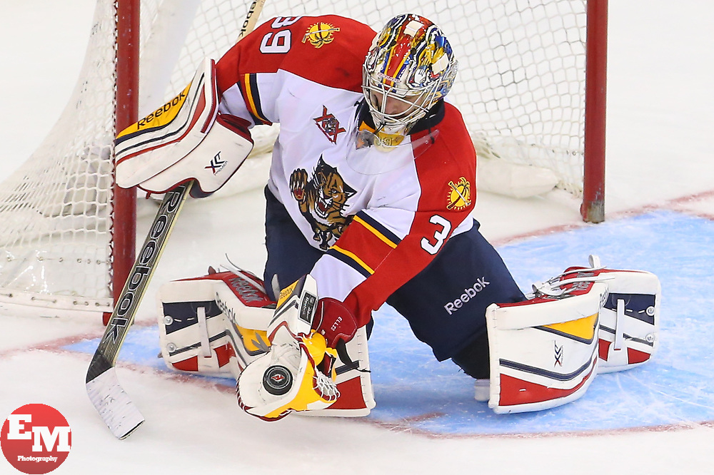Mar 31, 2014; Newark, NJ, USA; Florida Panthers goalie Dan Ellis (39) makes a save during the third period at Prudential Center. The Devils defeated the Panthers 6-3.