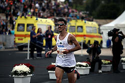 November 12, 2017 - Athens, Attica, Greece - Gkelaouzos Konstantinos enters the Panathenaic stadium at the 35th Athens Classic Marathon in Athens, Greece, November 12, 2017. (Credit Image: © Giorgos Georgiou/NurPhoto via ZUMA Press)