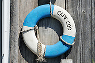 Cape Cod life ring on weathered wood on exterior of building, Yarmouth, Cape Cod, MA, USA