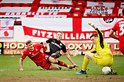 Barnsley forward Cauley Woodrow gets on a shot and Walsall FC goalkeeper Liam Roberts (1) sits on the ball to save during the EFL Sky Bet League 1 match between Walsall and Barnsley at the Banks's Stadium, Walsall, England on 23 March 2019.