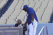 LOS ANGELES, CA - MAY 28:  Yasiel Puig #66 of the Los Angeles Dodgers shakes hands with former pitcher Don Newcombe of the Los Angeles Dodgers during batting practice before the game against the Cincinnati Reds at Dodger Stadium on Wednesday, May 28, 2014 in Los Angeles, California. The Reds won the game 3-2. (Photo by Paul Spinelli/MLB Photos via Getty Images) *** Local Caption *** Yasiel Puig;Don Newcombe
