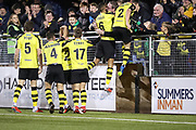 Harrogate Town defender Warren Burrell (6) and Harrogate Town defender Ryan Fallowfield (2) celebrate with the crowd after Harrogate Town's third goal during the Vanarama National League match between FC Halifax Town and Dover Athletic at the Shay, Halifax, United Kingdom on 17 November 2018.