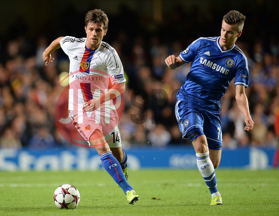 LONDON, ENGLAND - September 18: Basel's Valentin Stocker and Chelsea's Marco van Ginkel  during the UEFA Champions League Group E match between Chelsea from England and Basel from Switzerland played at Stamford Bridge, on September 18, 2013 in London, England. (Photo by Mitchell Gunn/ESPA)