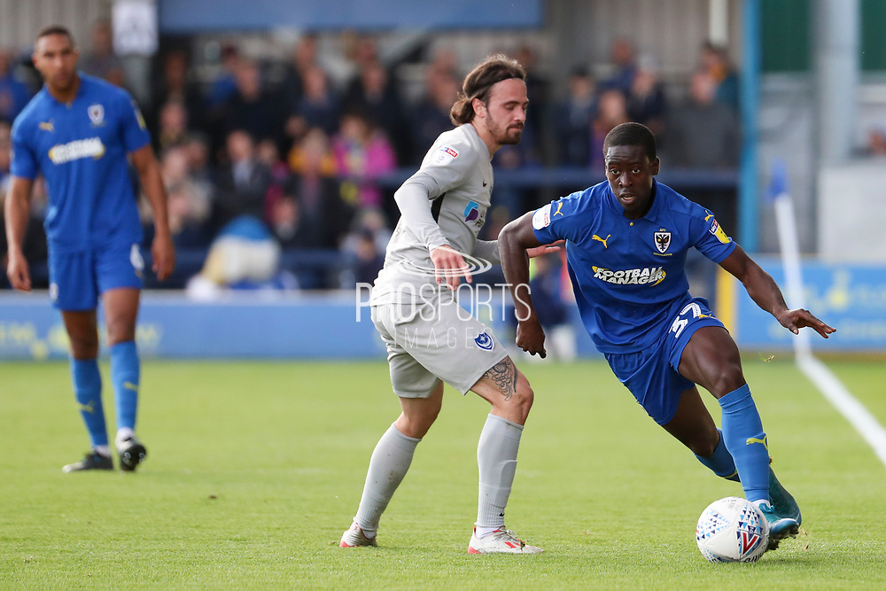 AFC Wimbledon defender Paul Osew (37) dribbling during the EFL Sky Bet League 1 match between AFC Wimbledon and Portsmouth at the Cherry Red Records Stadium, Kingston, England on 19 October 2019.