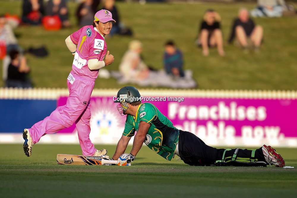 Northern Knight's BJ Watling is excited after Central Stag's Jamie How dives for the crease after a direct hit run out attempt during the HRV Cup - Northern Knights v Central Stags, Seddon Park, Hamilton.  23 November 2012.  Photo:  Bruce Lim / photosport.co.nz
