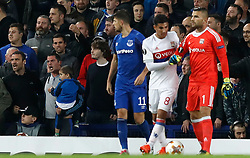 Lyon goalkeeper Anthony Lopes reacts after a fan holding a child (left) appears to push and aim a punch in his direction of himself and Lyon's Mouctar Diakhaby