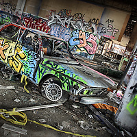 An old BMW car with graffiti