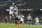 Nicolas Otamendi wins the ball during the Premier League match between Manchester City and Newcastle United at the Etihad Stadium, Manchester, England on 20 January 2018. Photo by George Franks.