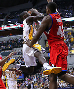 March 14, 2012; Indianapolis, IN, USA; Indiana Pacers point guard Darren Collison (2) takes the ball to the hoop against Philadelphia 76ers power forward Elton Brand (42) at Bankers Life Fieldhouse. Indiana defeated Philadelphia 111-94. Mandatory credit: Michael Hickey-US PRESSWIRE