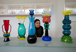 Visitor looking at modern glass vases on display at the Gemeentemuseum in The Hague, Den Haag,  Netherlands