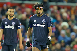 LIVERPOOL, ENGLAND - Saturday, January 30, 2016: West Ham United's Alex Song puts his protective glasses on his head during the FA Cup 4th Round match against Liverpool at Anfield. (Pic by David Rawcliffe/Propaganda)