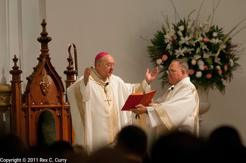Bishop Kevin Farrell, left, officiates, with the help of Deacon Charlie Stump, right, the easter service at  the Cathedral Shrine of the Virgin of Guadalupe in Dallas on April 24, 2011...(Rex C. Curry/Special Contributor)