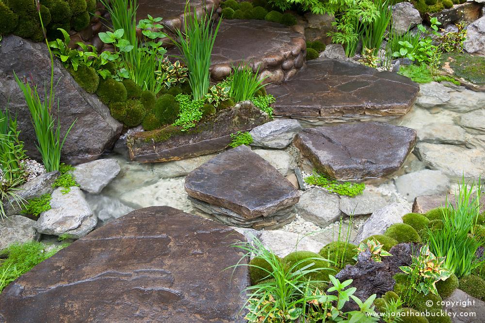 Edo no Niwa - Edo Garden. Stream and stepping stones in a Japanese garden. Gold medal winner Chelsea 2015. Design: Ishihara Kazuyuki Design Laboratory. Sponsor: Cat's Co Ltd. RHS Chelsea Flower Show 2015
