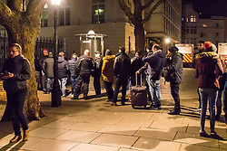 London, January 01 2018. Men queue to use a street urinal on Adelaide Street as revellers in London's West End enjoy New Year's Eve. © SWNS