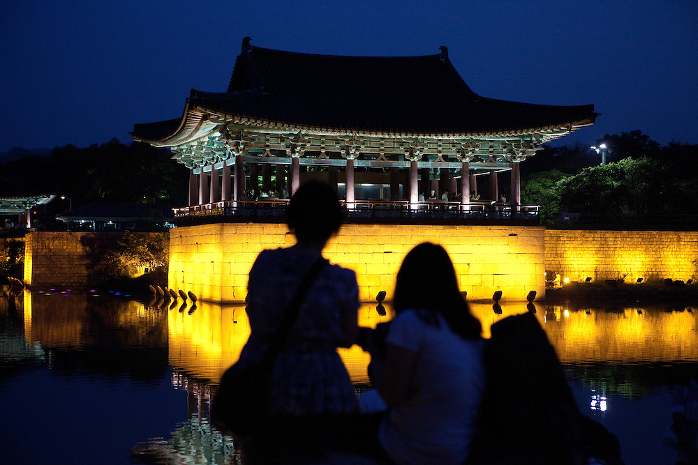 "People enjoying an evening at Anapji pond in the city of Gyeongju. Gyeongju was the capital of the ancient kingdom of Silla (57 BC - 935 AD) which ruled most of the Korean Peninsula between the 7th and 9th centuries. A vast number of archaeological sites and cultural properties from this period remain in the city. Gyeongju is often referred to as ""the museum without walls"". / Gyeongju, South Korea, Republic of Korea, KOR, 20th of May 2010."