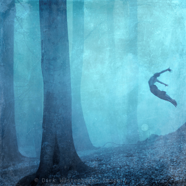 A beech tree forest covered in mist. I'd like the idea of adding something surreal. Hence I added the jumping man.