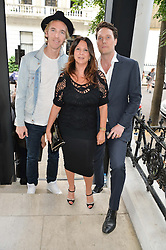 Left to right, JAMES COOK, FRAN CUTLER and JACK MACDONALD at a private view and launch of the new Heist Gallery at 43 Linden Gardens, London W2 on 12th June 2014.