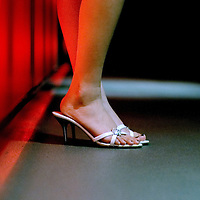 young female standing wearing slip on shoes for a night out