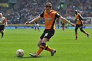 Hull City defender Andrew Robertson (26) crosses the ball  during the Sky Bet Championship match between Hull City and Rotherham United at the KC Stadium, Kingston upon Hull, England on 7 May 2016. Photo by Ian Lyall.