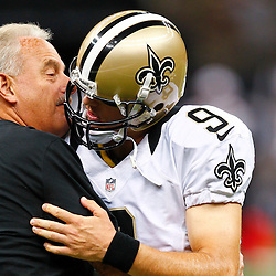 August 17, 2012; New Orleans, LA, USA; New Orleans Saints assistant head coach and linebackers coach Joe Vitt and quarterback Drew Brees (9) embrace prior to kickoff of a preseason game against the Jacksonville Jaguars at the Mercedes-Benz Superdome. Mandatory Credit: Derick E. Hingle-US PRESSWIRE