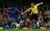 Photo: Alan Crowhurst.<br />Chelsea v Manchester City. The Barclays Premiership. 25/03/2006. Chelsea's Michael Essien challenges with Lee Croft.