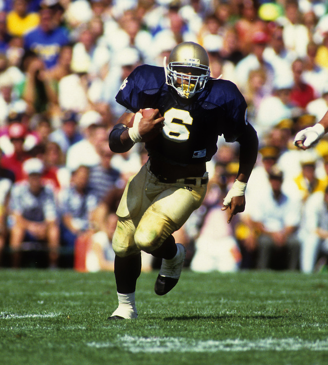SOUTH BEND, IN-UNDATED:  NFL and Notre Dame running back Jerome Bettis runs with the ball during a game in South Bend, Indiana.   Bettis played for Notre Dame from 1990-1992.  (Photo by Ron Vesely)