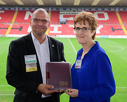BNI Apollo chapter president Simon Meadows (Sterling Business Coaching), left, presents the chapter's newest member Rachel Martel (Opportunity Marketing) with her member pack.  The BNI Apollo (Lincoln) chapter meet at Sincil Bank Stadium, home of Lincoln City FC on Thursday mornings (9.15am - 11am).<br /> <br /> Picture: Chris Vaughan Photography<br /> Date: October 26, 2017