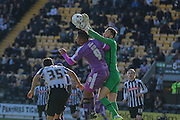 Notts County goalkeeper Scott Loach claims the ball off Plymouth Argyle forward Reuben Reid  head during the Sky Bet League 2 match between Notts County and Plymouth Argyle at Meadow Lane, Nottingham, England on 11 October 2015. Photo by Simon Davies.
