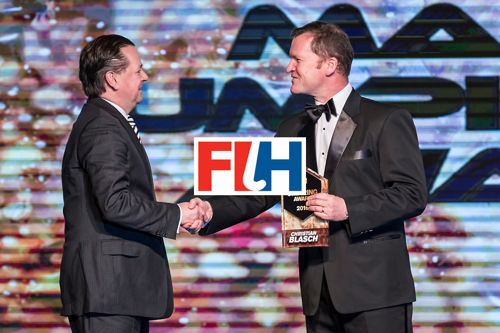 CHANDIGARH, INDIA - FEBRUARY 23: Winner of the FIH Male Umpiring Award Christian Blasch of Germany award received by Delf Ness [L], DHM Member presented by Jason McCraken [R], CEO of The International Hockey Federation during the FIH Hockey Stars Awards 2016 at Lalit Hotel on February 23, 2017 in Chandigarh, India. (Photo by Ali Bharmal/Getty Images for FIH)