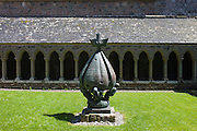 Cloisters and modern bronze sculpture - 'Descent of the Spirit' by Lithuanian artist Jacques Lipchitz at Iona Abbey on Isle of Iona in the Inner Hebrides and Western Isles, Scotland