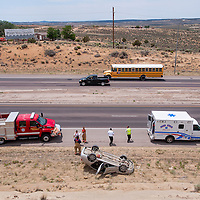 061313       Cable Hoover<br /> <br /> Navajo Estates firefighters and McKinley County Sheriff's officers respond to a single-vehicle rollover in the northbound lane of US Highway 491 near Yatahey Thursday.