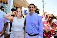 Massapequa, New York, USA. August 5, 2018. L-R, LIUBA GRECHEN SHIRLEY, Congressional candidate for NY 2nd District, and Governor ANDREW CUOMO, running for re-election, walk together mingling with supporters during opening of joint campaign office for Grechen Shirley and NY Sen. J. Brooks, aiming for a Democratic Blue Wave in November midterm elections.