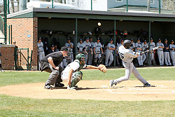 14 April 2013:  Chris Fisher fouls off a pitch over the head of A.J. Nathan and umpire Steve Jones during an NCAA division 3 College Conference of Illinois and Wisconsin (CCIW) Baseball game between the Elmhurst Bluejays and the Illinois Wesleyan Titans in Jack Horenberger Stadium, Bloomington IL