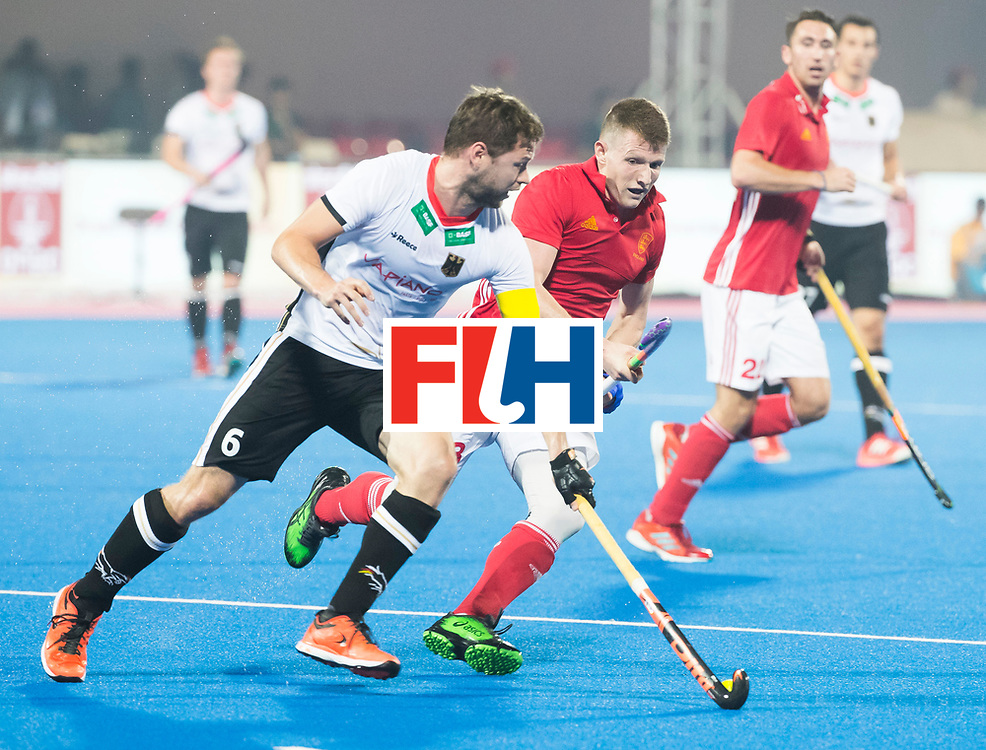 BHUBANESWAR - The Odisha Men's Hockey World League Final . Match ID 01 . Germany v England (2-0). Martin Haener (Ger) with Sam Ward (Eng)  .WORLDSPORTPICS COPYRIGHT  KOEN SUYK