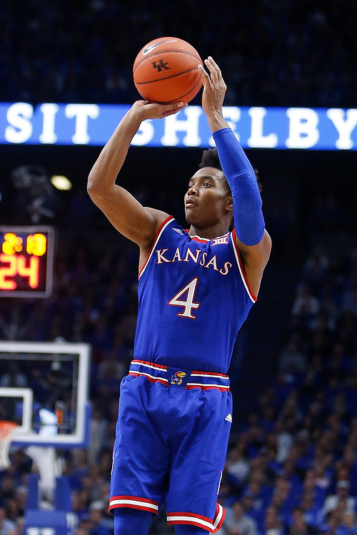 Kansas Jayhawks guard Devonte' Graham shoots a three against the Kentucky Wildcats on Saturday January 28, 2017 at Rupp Arena in Lexington, Ky. Photo by Michael Reaves | Staff
