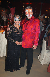 ROLF HARRIS and his wife at the 2004 Goodwood Revival ball this year theme was a Venetian Masked Ball, held at Goodwood Motor Racing circuit, West Sussex on 4t September 2004.